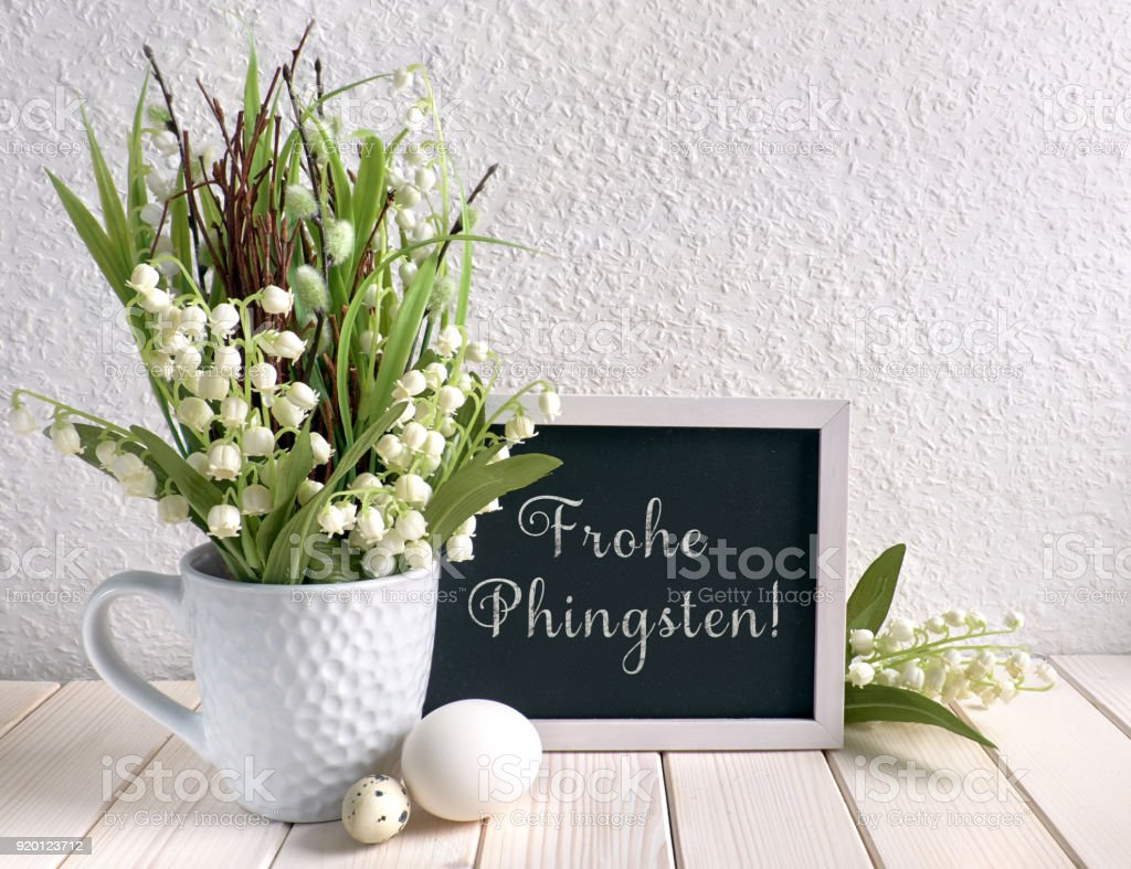 Blackboard decorated with lily of the valley flowers and eggs text blackboard decorated with lily of the valley flowers and eggs text royalty free stock izmirmasajfo