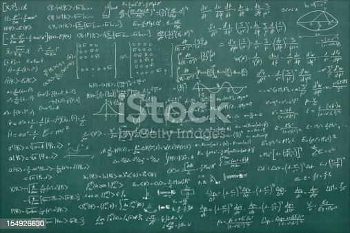 Blackboard full of equations (quantum, relativty....)