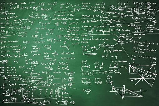 Complex mathematical formulas on blackboard.
