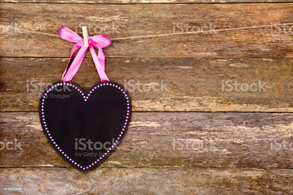 Blackboard Heart With Pink Border And Ribbon On Clothespin Against