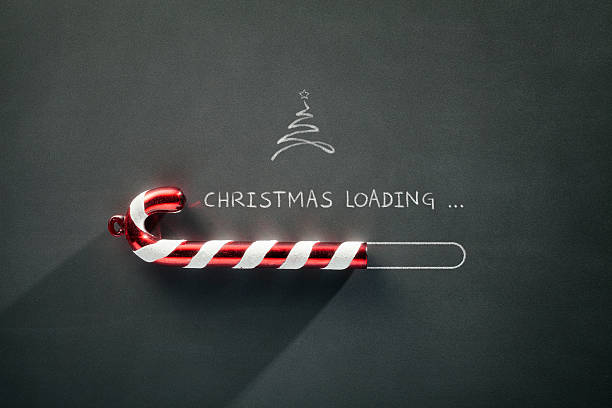 blackboard holiday decoration - christmas loading candy cane - christmas stock photos and pictures