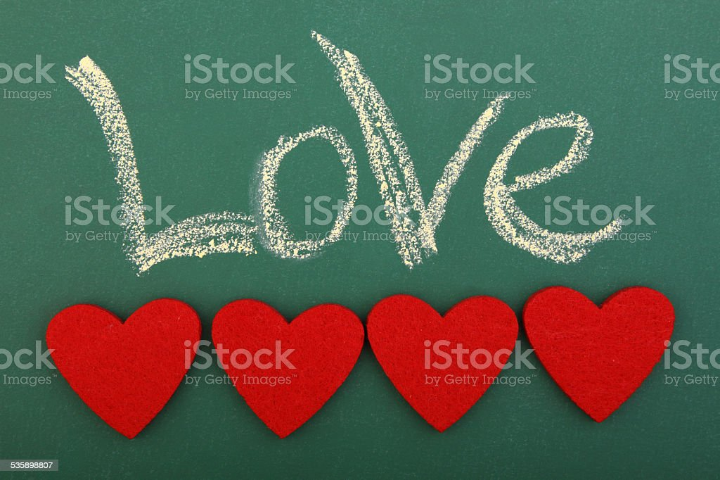 Blackboard love with four hearts stock photo