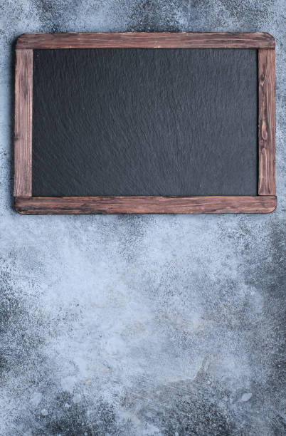 Cтоковое фото Blackboard on concrete