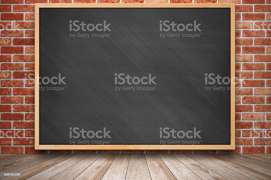 Blackboard on red brick wall texture and wooden floor.