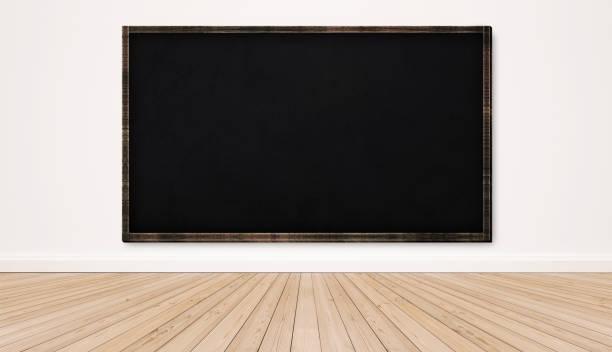 Blackboard on white wall with wood floor, empty classroom stock photo