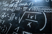 A blackboard filled with formulas and equations