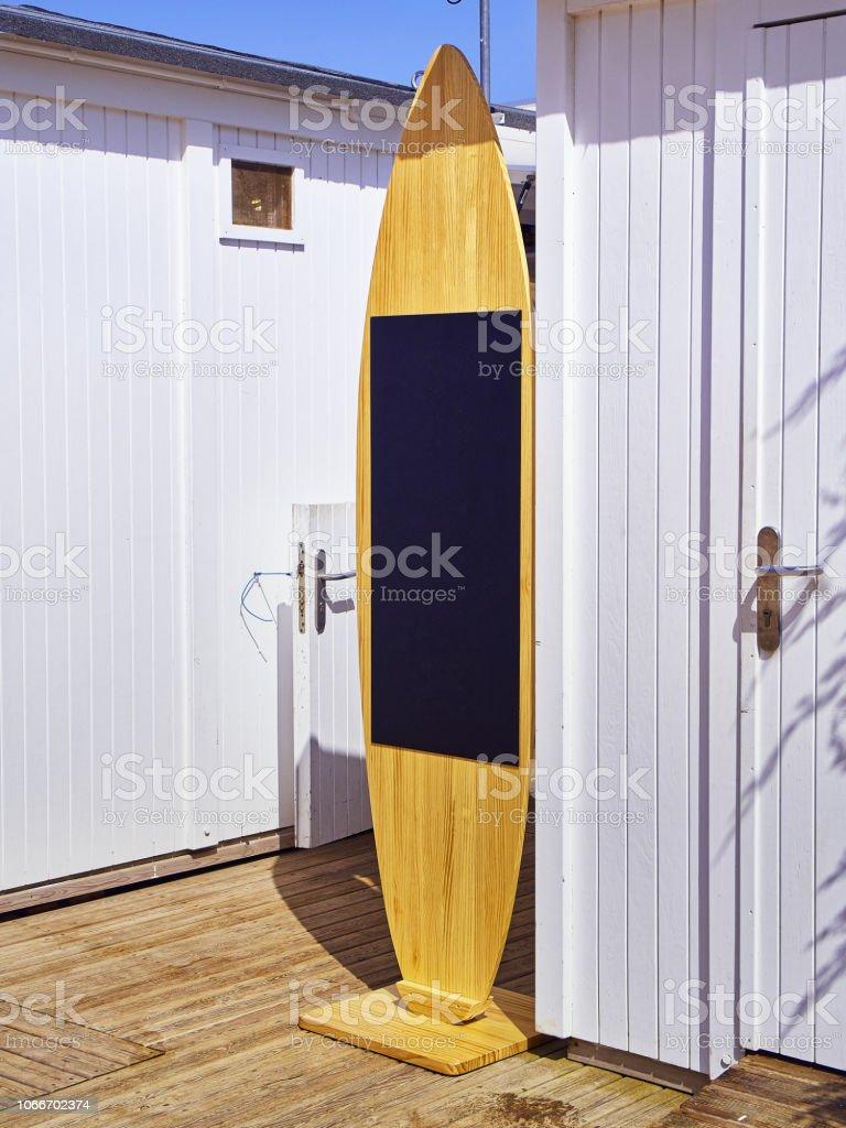 A blackboard shaped Surfboard. stock photo