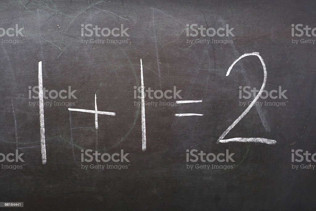 A blackboard showing a simple mathematical sum in chalk royalty-free stock photo