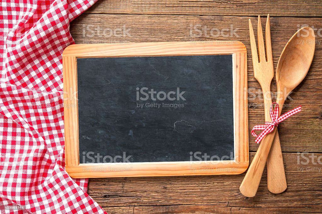 Blackboard with a red checkered tablecloth stock photo