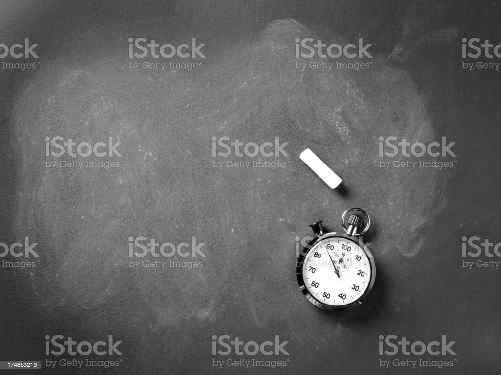 Blackboard with Chalk and a Stopwatch royalty-free stock photo