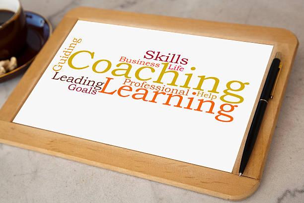 Tafel mit coaching-word cloud – Foto
