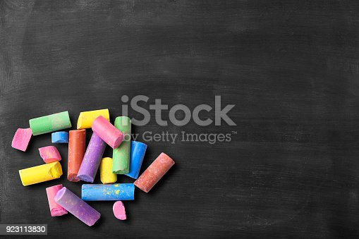 istock Blackboard with colorful broken chalks 923113830
