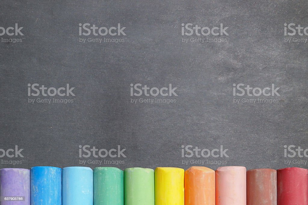 Blackboard with colorful chalk sticks - Photo