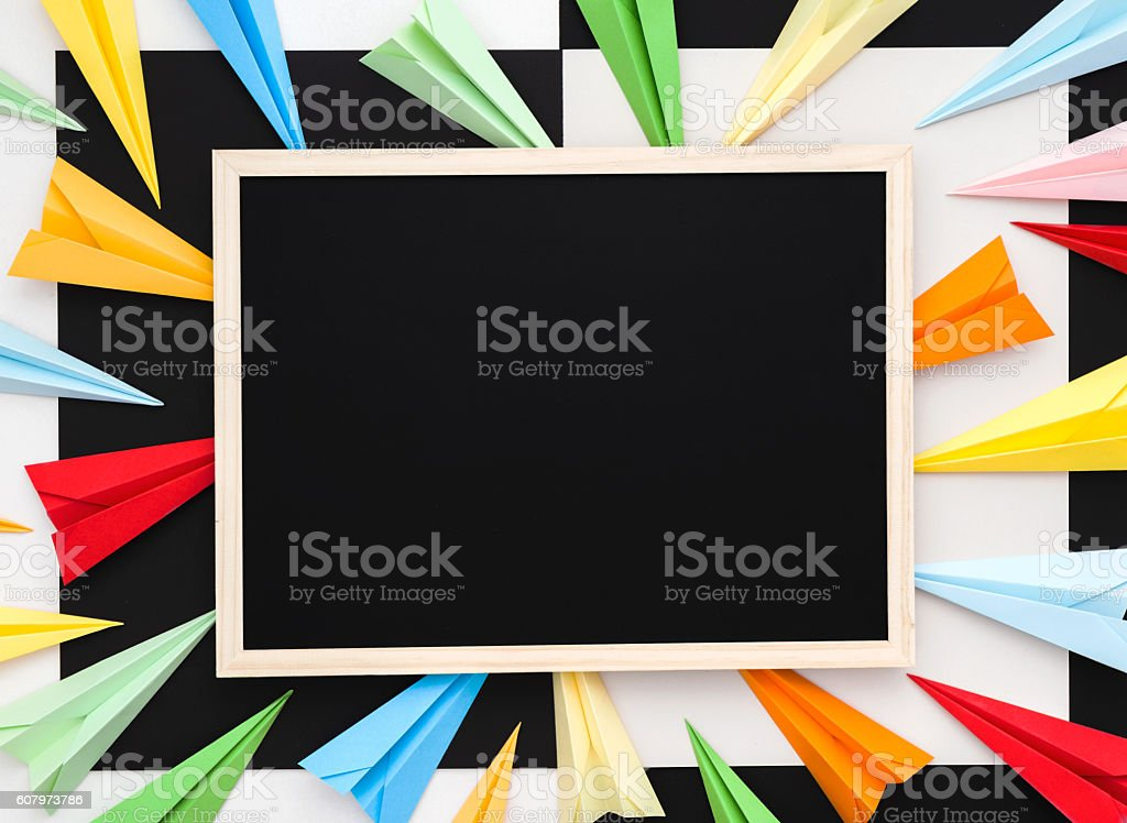 Blackboard with colorful paper planes. Success concept. stock photo