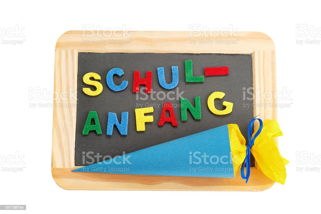 blackboard with conical bag of sweets stock photo