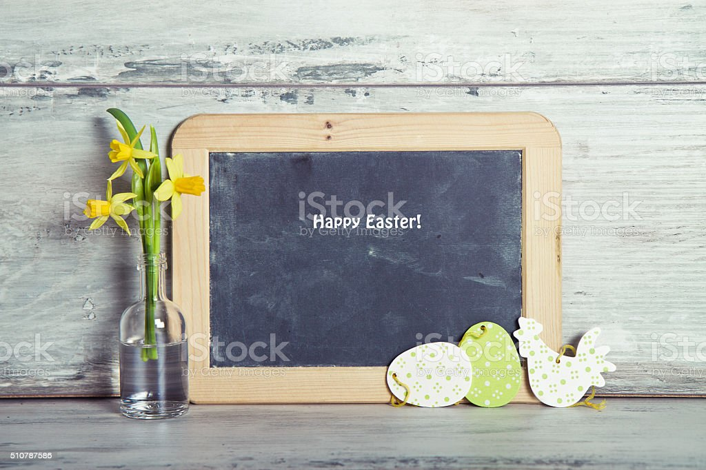 Blackboard with daffodils and Easter decoration stock photo
