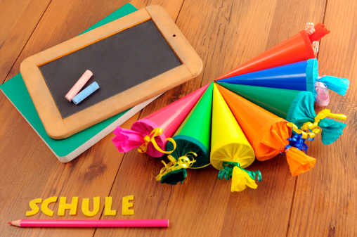 blackboard with German word Schule and Conical bag of sweets
