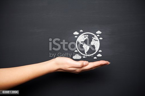 istock Blackboard with hand and globe 638813890