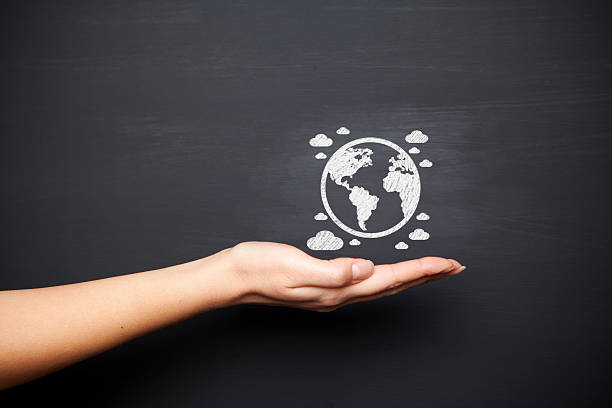 blackboard with hand and globe - responsible business stock photos and pictures