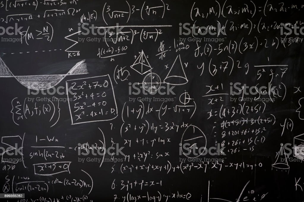 Blackboard with maths statistics, equations and ideas stock photo