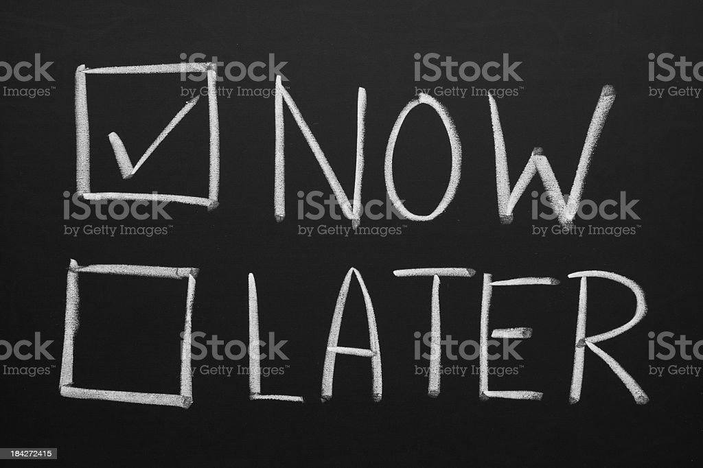 Blackboard with now and later check boxes royalty-free stock photo