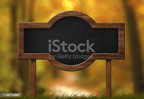 istock Blackboard with rounded shape autumn forest background 1158704887