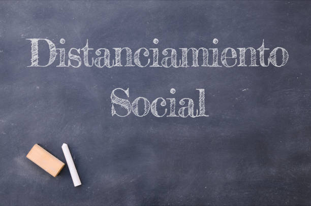 Blackboard with Social distancing written in spanish stock photo