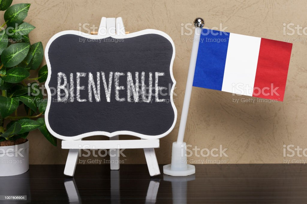 Blackboard with text ,, Bienvenue ' (Welcome) and flag of France stock photo