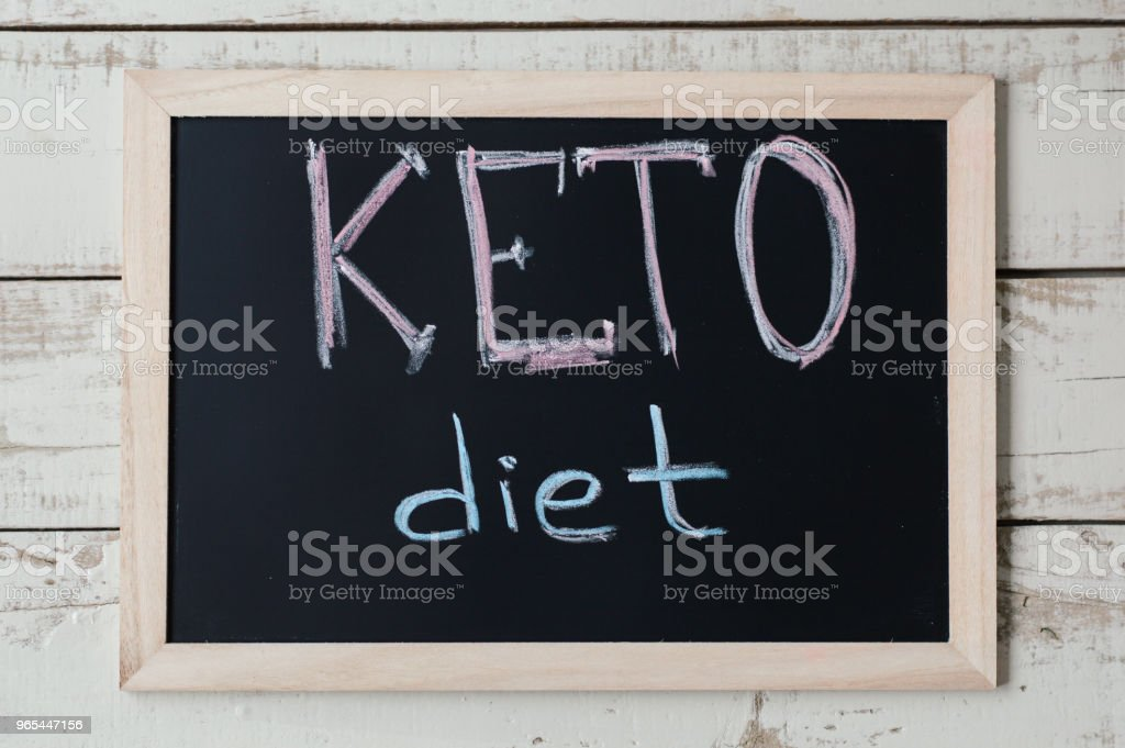 Blackboard with text 'Keto Diet' on wooden background, top view. Ketogenic diet concept, a new trend in slimming. Nutrition concept zbiór zdjęć royalty-free