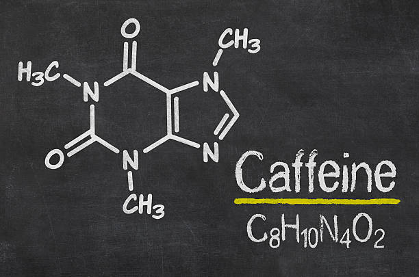 Blackboard with the chemical formula of Caffeine Blackboard with the chemical formula of Caffeine caffeine stock pictures, royalty-free photos & images