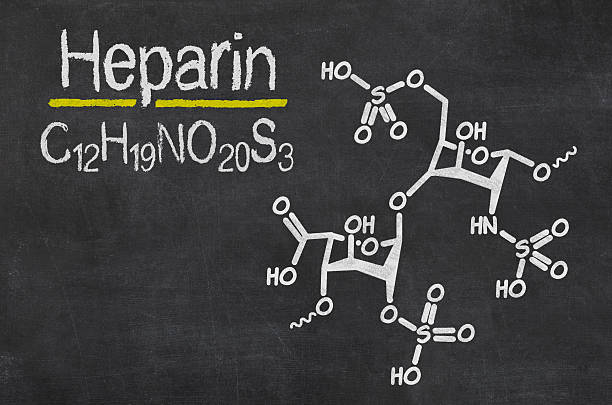 Blackboard with the chemical formula of Heparin Blackboard with the chemical formula of Heparin anticoagulant stock pictures, royalty-free photos & images