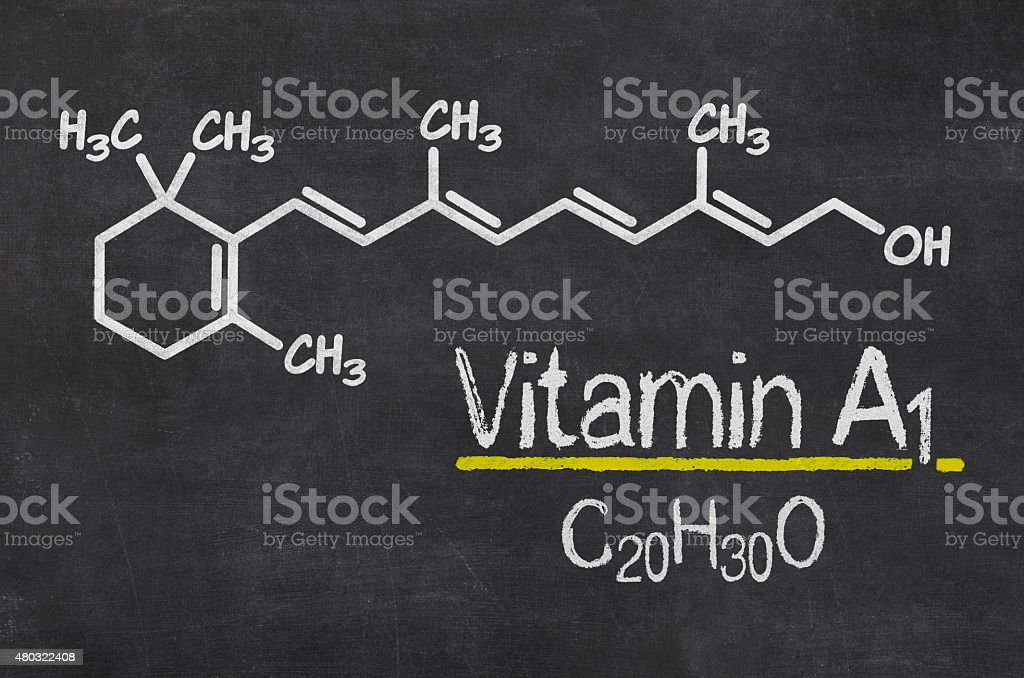 Blackboard with the chemical formula of Vitamin A1 stock photo