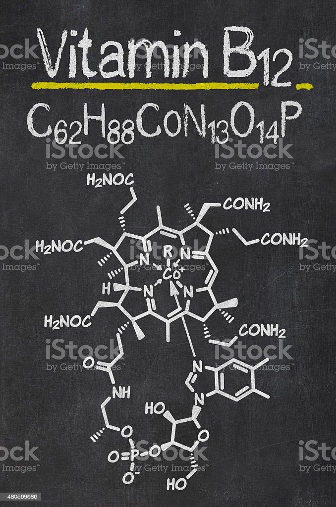 Blackboard with the chemical formula of Vitamin B12 stock photo