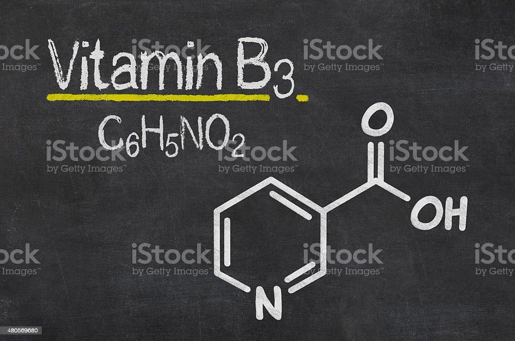 Blackboard with the chemical formula of Vitamin B3 stock photo