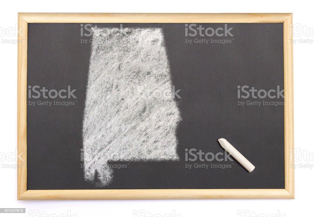 Blackboard with the shape of Alabama drawn onto. stock photo