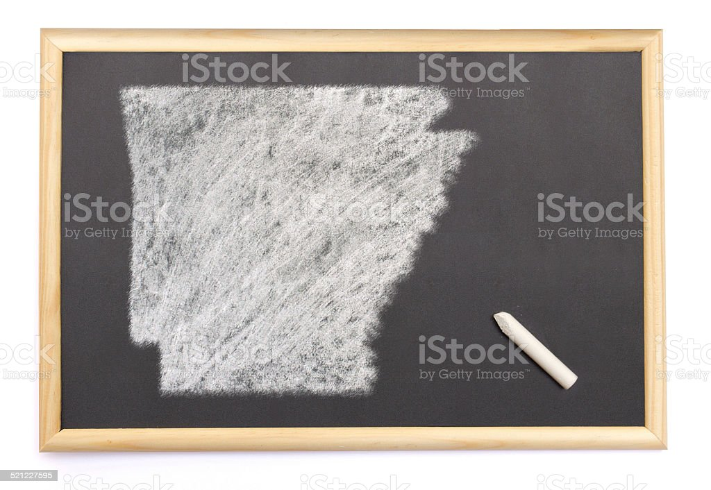 Blackboard with the shape of Arkansas drawn onto. stock photo