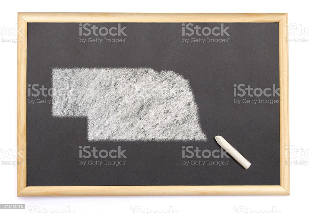 Blackboard with the shape of Nebraska drawn onto. stock photo