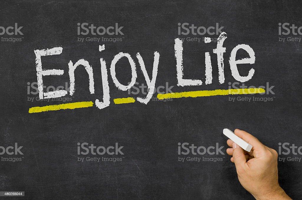 Blackboard with the text Enjoy Life stock photo