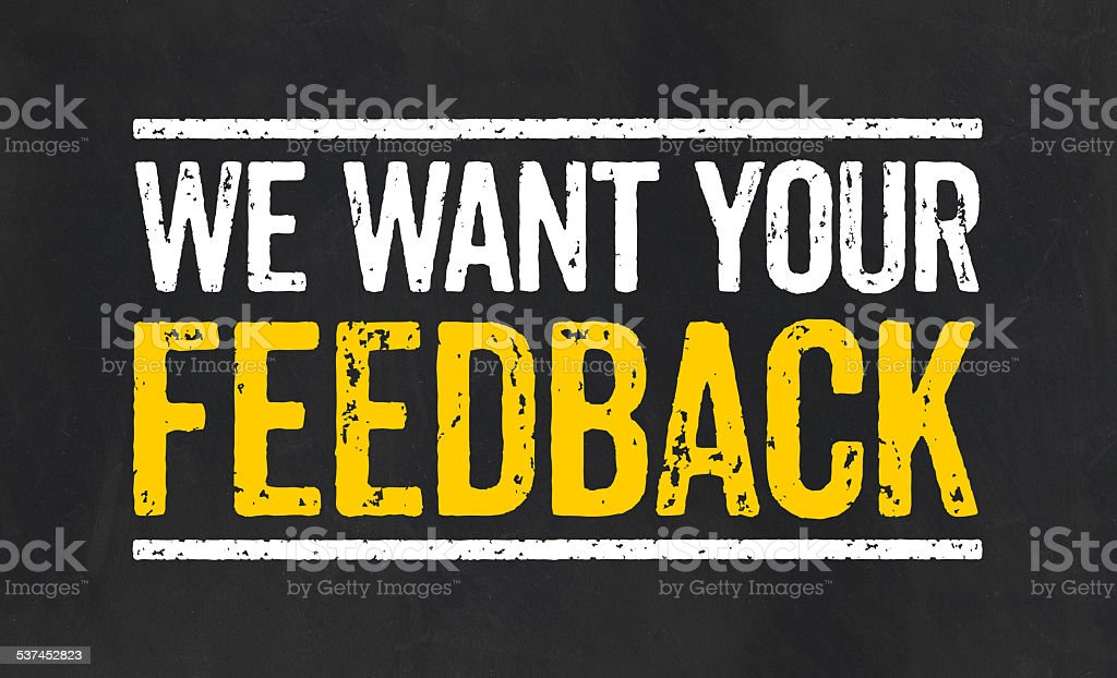 Blackboard with the text We want your feedback stock photo