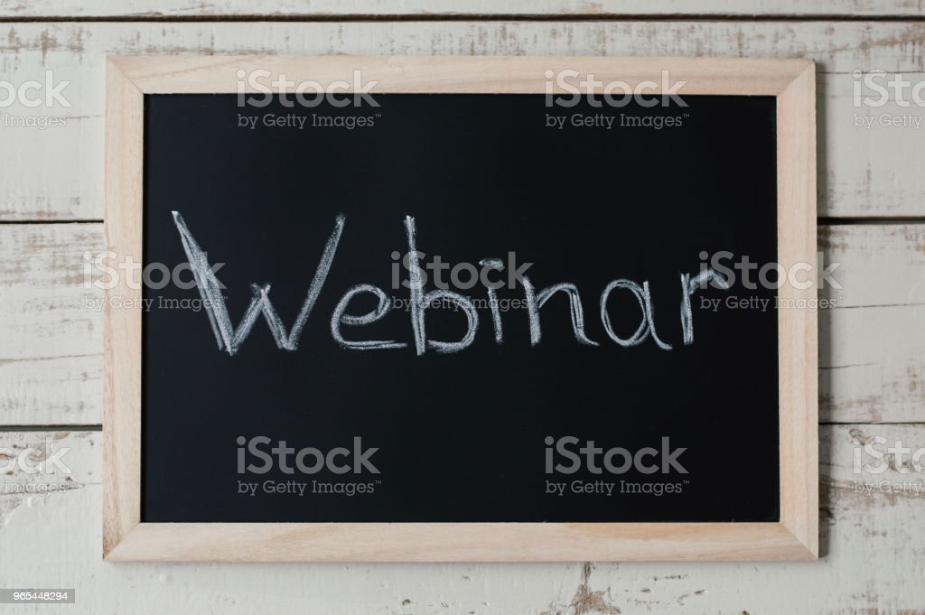 Blackboard with the text 'Webinar'. E-learning and e-commerce concept. Online seminar zbiór zdjęć royalty-free