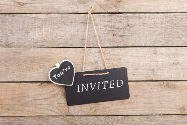 "blackboards with text ""you're invited"" on wooden background - guest stock pictures, royalty-free photos & images"