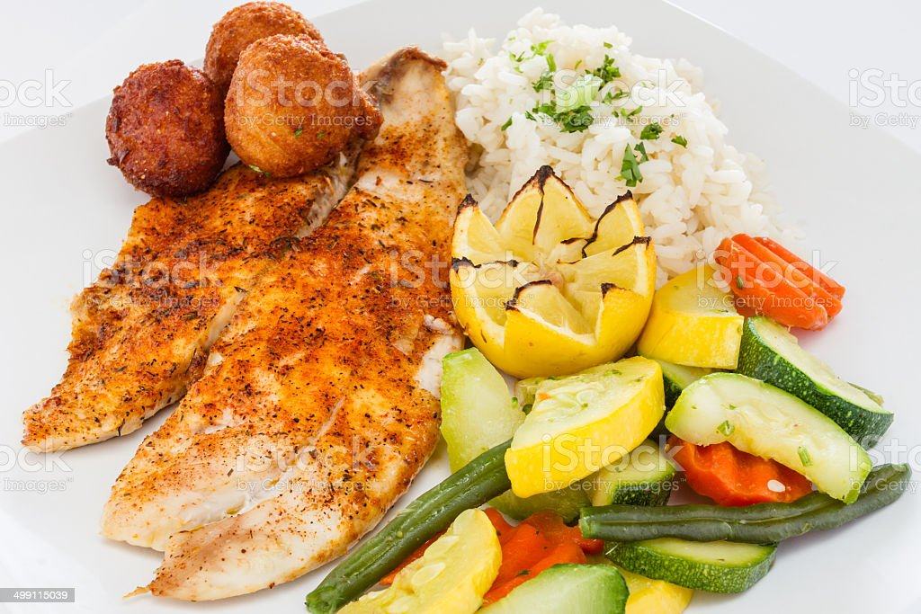 Blackened fish with sides. stock photo