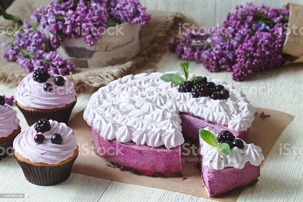 Blackerry purple souffle cake. Traditional delicious homemade baked sweet decorated stock photo