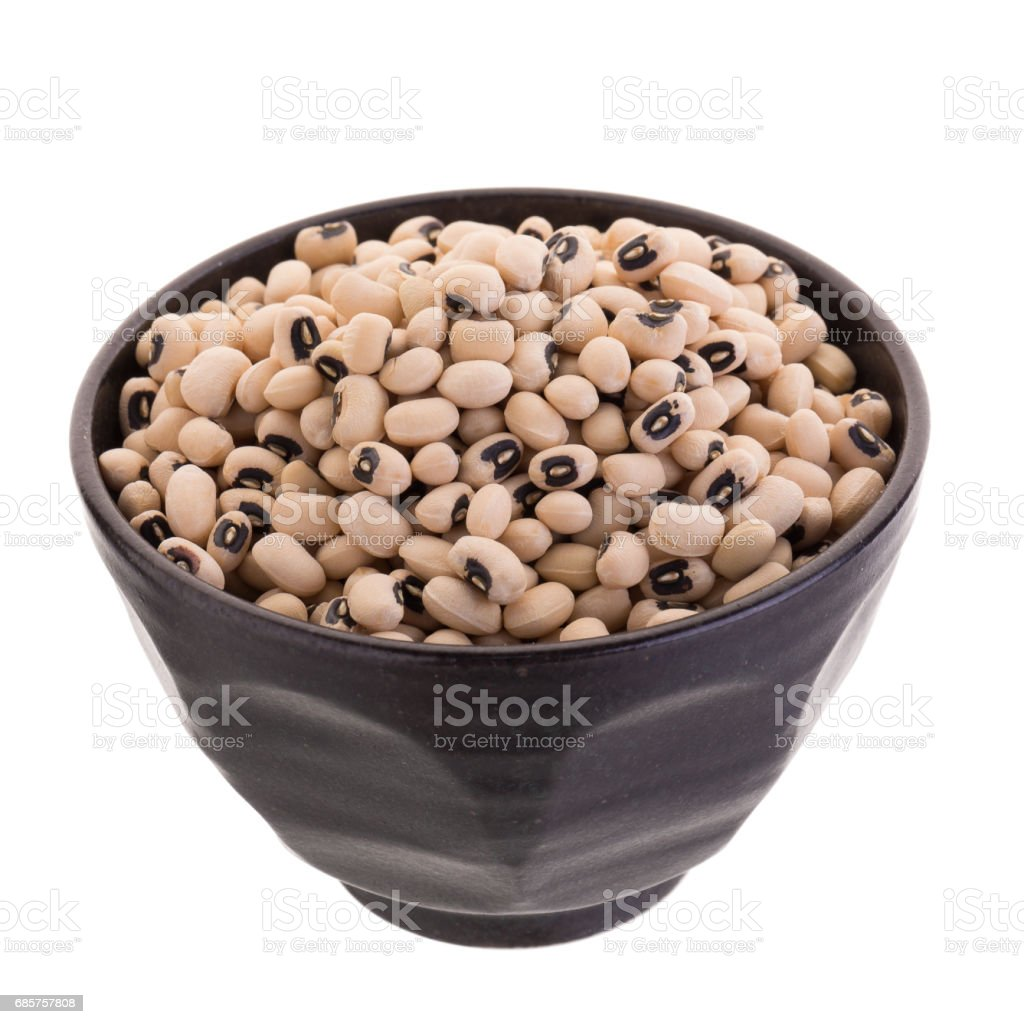 Black-eyed peas in a ceramic bowl isolated on a white background royalty-free stock photo