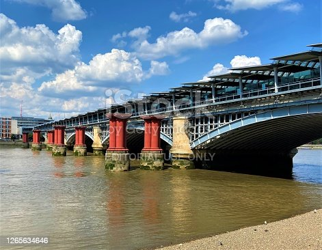 London, United Kingdom - June 26 2020: Blackfriars Railway Bridge with solar panels and River Thames daytime view from South Bank