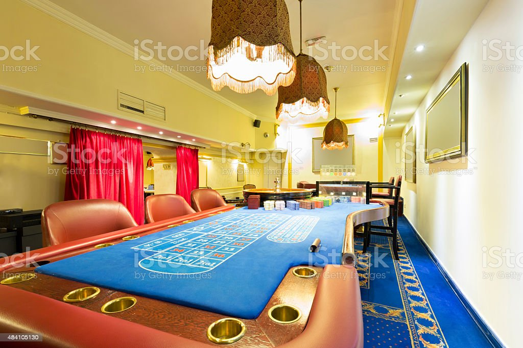 Blackjack and roulette tables at casino stock photo