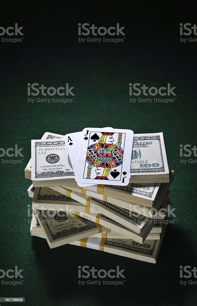 BlackJack Playing Cards and a Pile of Money royalty-free stock photo