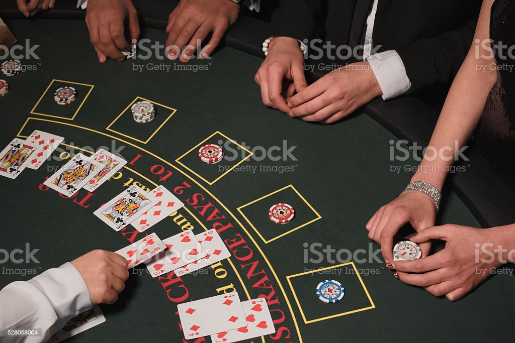 Blackjack table and players in the casino stock photo