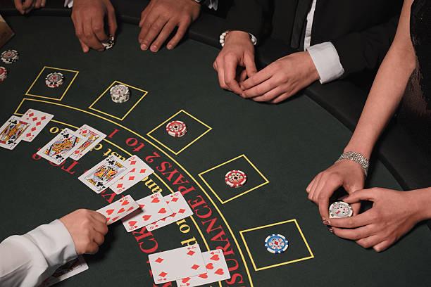 blackjack table and players in the casino - black jack bildbanksfoton och bilder