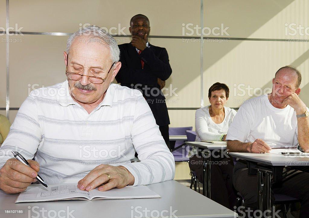 Blackl teacher and senior students in education room stock photo